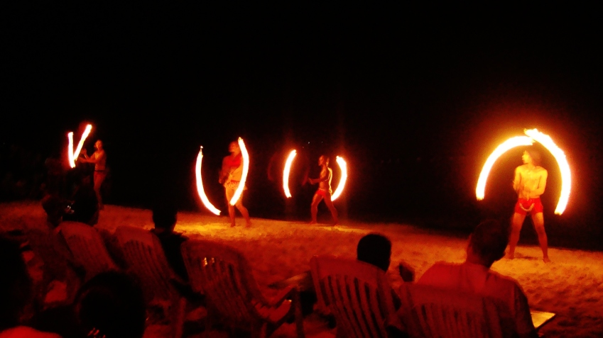 Flaming fire dancers